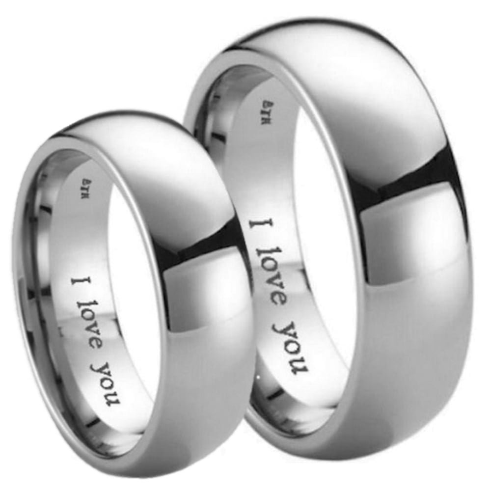 It is an image of His and Hers Matching Titanium Wedding Couple Ring Sets -Engraved with 'I Love You'